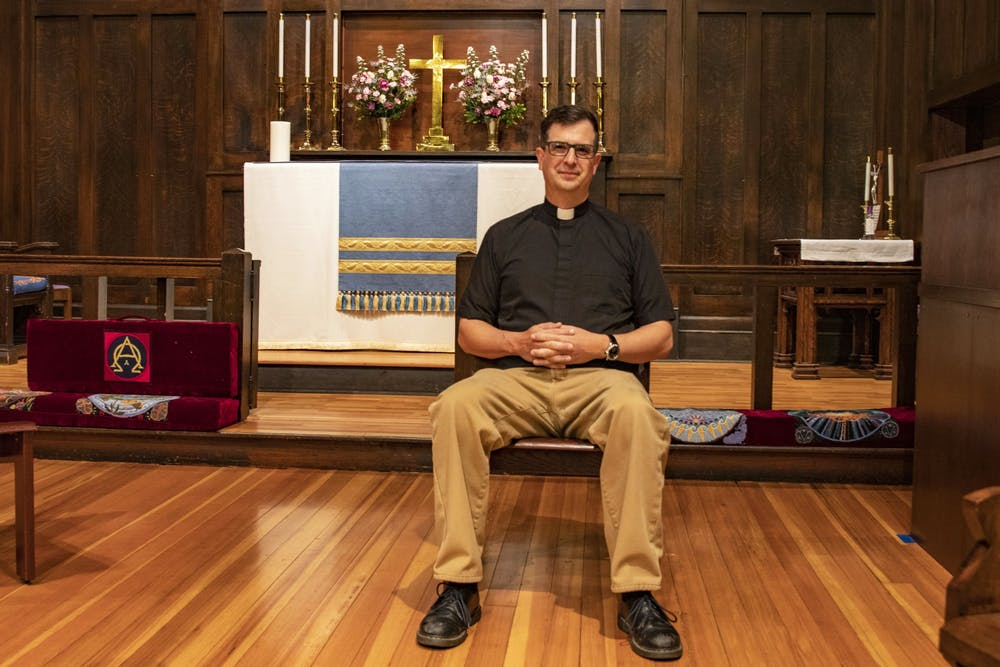 <p>The Rev. Matt Seddon sits on a chair April 19, 2021, in the Trinity Episcopal Church in Bloomington. Trinity is a LGBTQ-welcoming church, according to its website.</p>