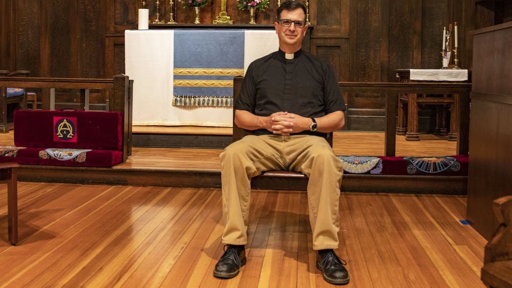 The Rev. Matt Seddon sits on a chair April 19, 2021, in the Trinity Episcopal Church in Bloomington. Trinity is a LGBTQ-welcoming church, according to its website.