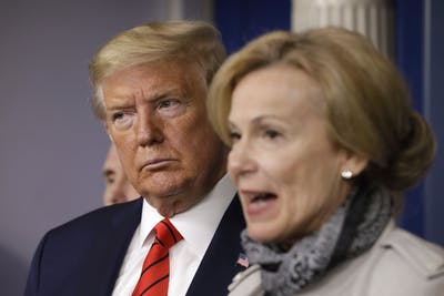 President Donald Trump listens to White House Coronavirus Response Coordinator Dr. Deborah Birx during a press briefing on the coronavirus pandemic with members of the Coronavirus Task Force on March 19 at the White House.