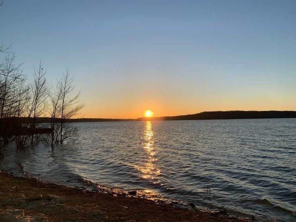 The sun rises March 30, 2021 on Monroe Lake.