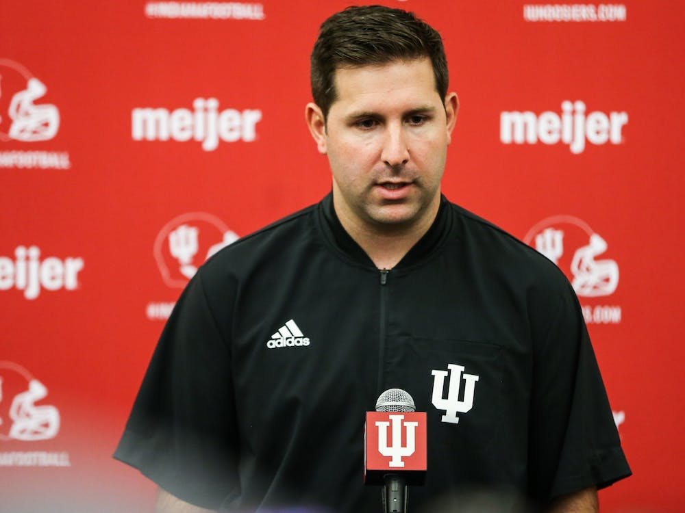 IU football offensive coordinator and quarterbacks coach Nick Sheridan speaks during Media Day on Thursday in Bloomington. Sheridan said the team will be able to see what graduate student running back Stephen Carr can do on the field in the next two weeks.