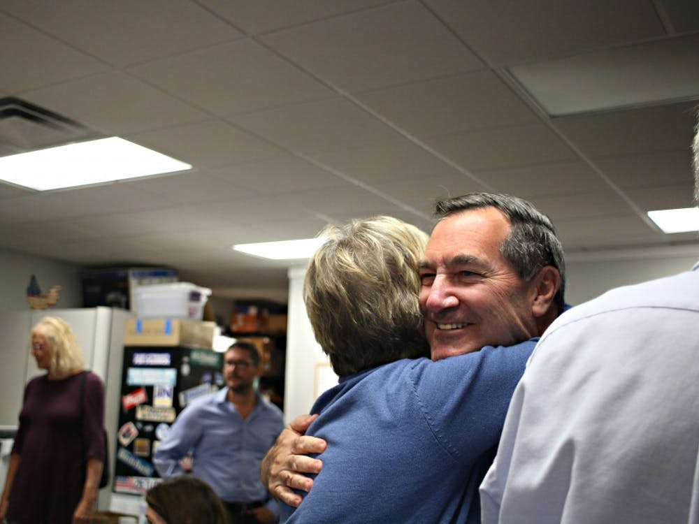 Sen. Joe Donnelly (D-Indiana) hugs a woman in the crowd that gathered Oct. 23 at the Indiana Democratic Coordinated Campaign field office. Donnelly traveled to Bloomington to encourage people to vote early for the midterm elections.