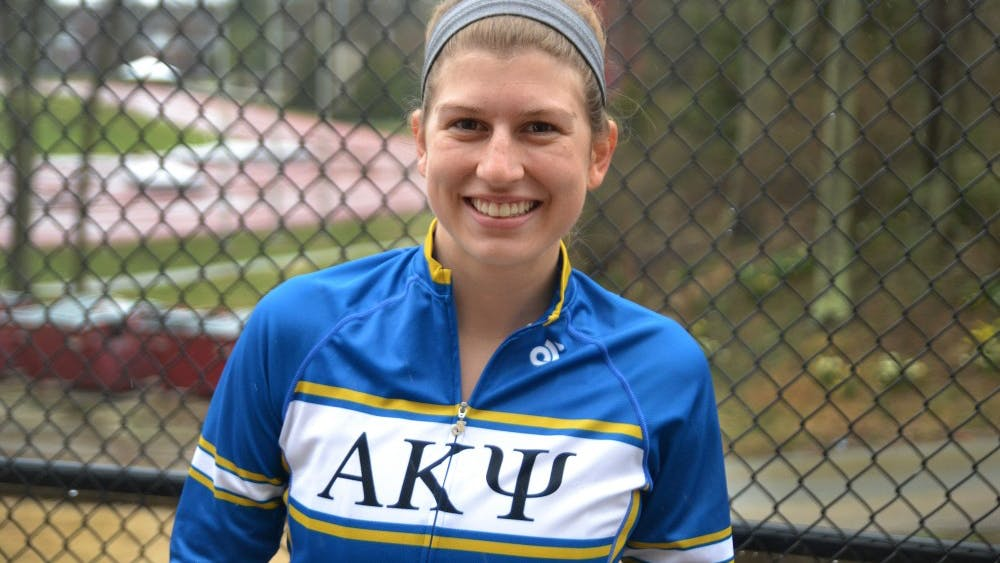 Dana Walker, rider for Alpha Kappa Psi, stands March 30 at Bill Armstrong Stadium.