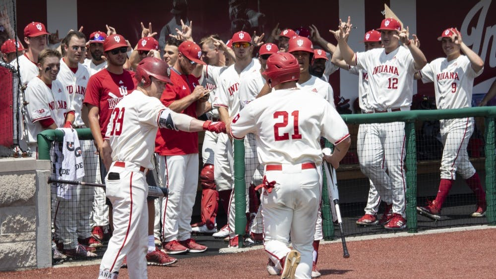 IU's baseball team cheers as it welcomes sophomore outfielder Elijah Dunham back to the dugout May 18 at Bart Kaufman Field. Dunham scored at the bottom of the fourth inning against Rutgers.