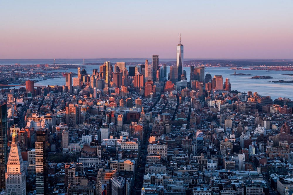 <p>The Manhattan skyline is seen at sunrise from the 86th floor observatory of the Empire State Building on April 3, 2021, in New York City. </p>