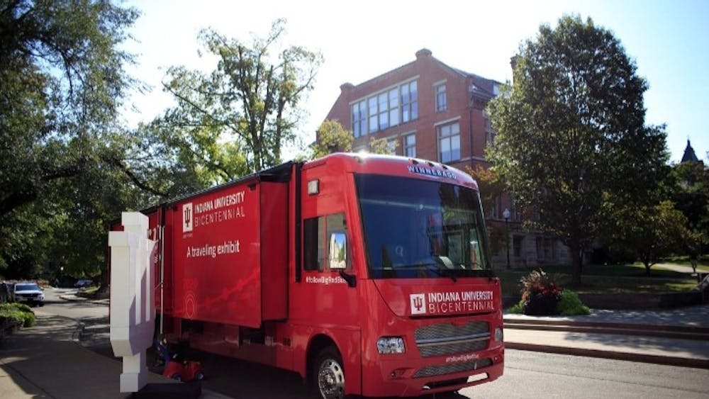 """IU's Office of the Bicentennial is taking IU's history on the road with its interactive exhibit on the """"Big Red Bus."""""""