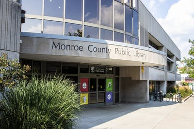 Monroe County Public Library is located at 303 E. Kirkwood Ave. Because of rising parking costs, the City of Bloomington is cutting down the amount of parking passes available to the library's 140 employees from 50 to 12.