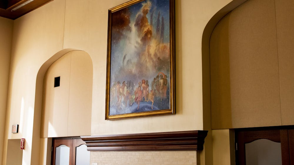 """""""Lux et Veritas,"""" or """"Light and Truth,"""" by professor Bonnie Sklarski hangs in Presidents Hall on Sept. 21 in Franklin Hall."""