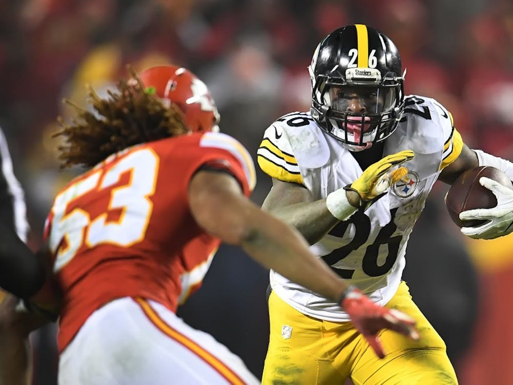 The Pittsburgh Steelers' Le'Veon Bell rushes against the Kansas City Chiefs during the AFC Divisional Playoffs on Jan. 15 at Arrowhead Stadium in Kansas City, Missouri.