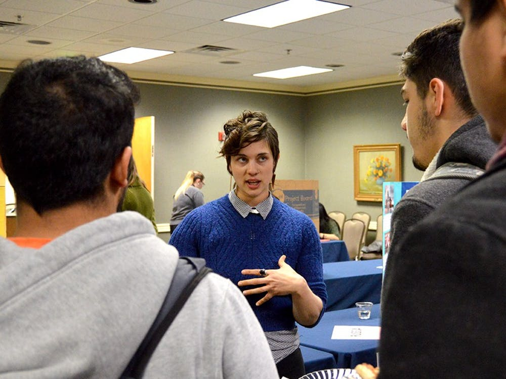 "Jen Burch, center, crisis intervenction services coordinator at Middle Way House, informs students about human trafficking Tuesday at State Room East in the Indiana Memorial Union. ""The Hidden Reality: An Interactive Program on Human Trafficking"" included an interactive process that led participants through various countries where human trafficking occurs."