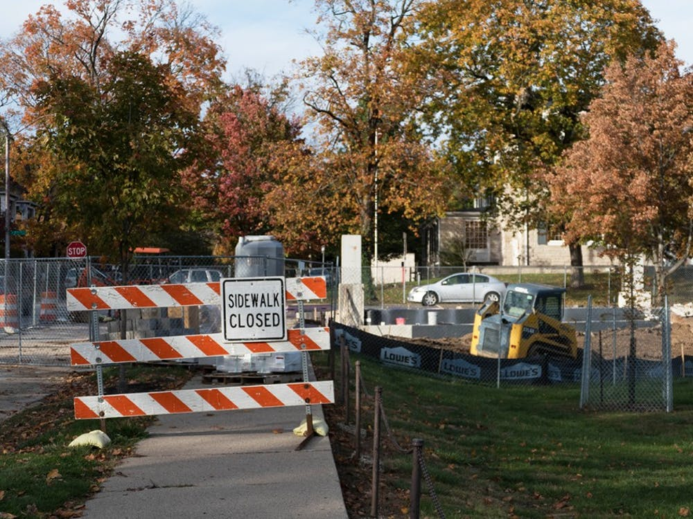Construction blocks the sidewalk Tuesday at Seventh Street and Indiana Avenue. IU has been constructing a $340,000 gateway on the corner.