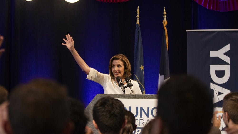 House Speaker Nancy Pelosi waves goodbye towards the end of her speech July 19 at the Crowne Plaza in Indianapolis. Pelosi spoke at the 2019 Young Democrats of America National Convention.