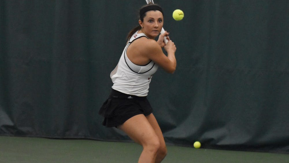 Freshman Michelle McKamey prepares for a backhand during her 2-6, 6-4, 7-6 win over Xavier University. IU won against Xavier, 6-1, and improved to 4-0 on the season.