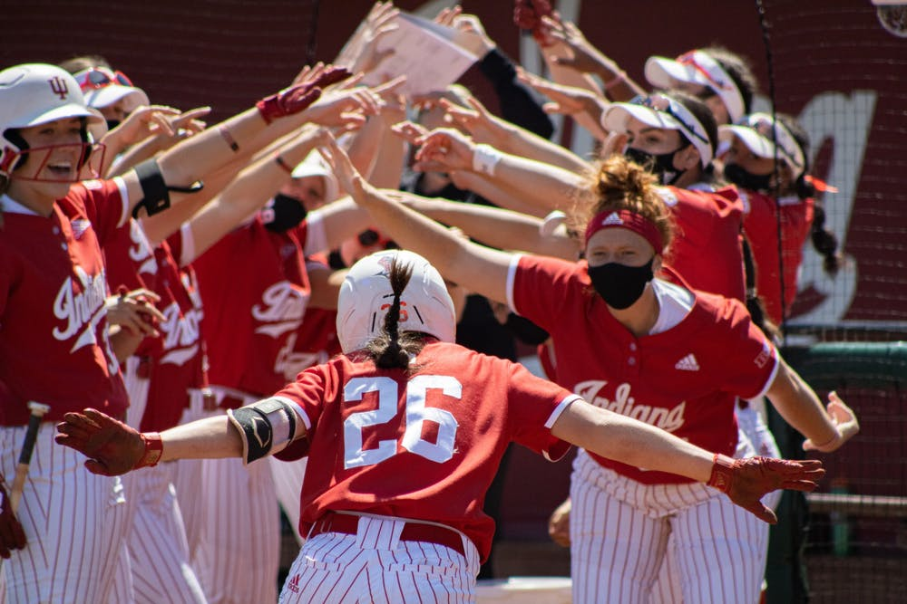 <p>Senior infielder Grayson Radcliffe celebrates with her teammates after hitting a home run against Michigan State on Saturday at Andy Kaufman Field. The IU softball team went 2-1 this weekend against Michigan State at home. </p>