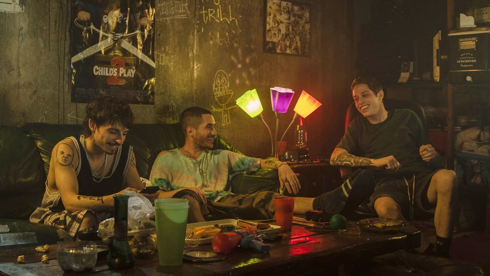"""Moisés Arias, Ricky Velez and Pete Davidson are seen in the 2020 film """"The King of Staten Island."""" Velez will be performing April 30-May 1 at the Comedy Attic in Bloomington."""