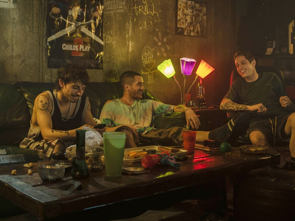 "Moisés Arias, Ricky Velez and Pete Davidson are seen in the 2020 film ""The King of Staten Island."" Velez will be performing April 30-May 1 at the Comedy Attic in Bloomington."