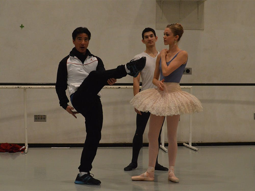"Senior Lecturer in Music Guo Ping Wang instructs Cara Hansvick and her partner, Andrew Copeland, as they rehearse for IU Opera & Ballet Theater's ""The Nutcracker"" ballet. The opening performance of ""The Nutcracker"" will be at 7:30 p.m. Dec. 3 in the Musical Arts Center."