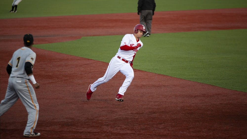 Junior Matt Gorski sprints to third base March 22 at Bart Kaufman Field. Gorski then ran home to score IU's second point of the game.