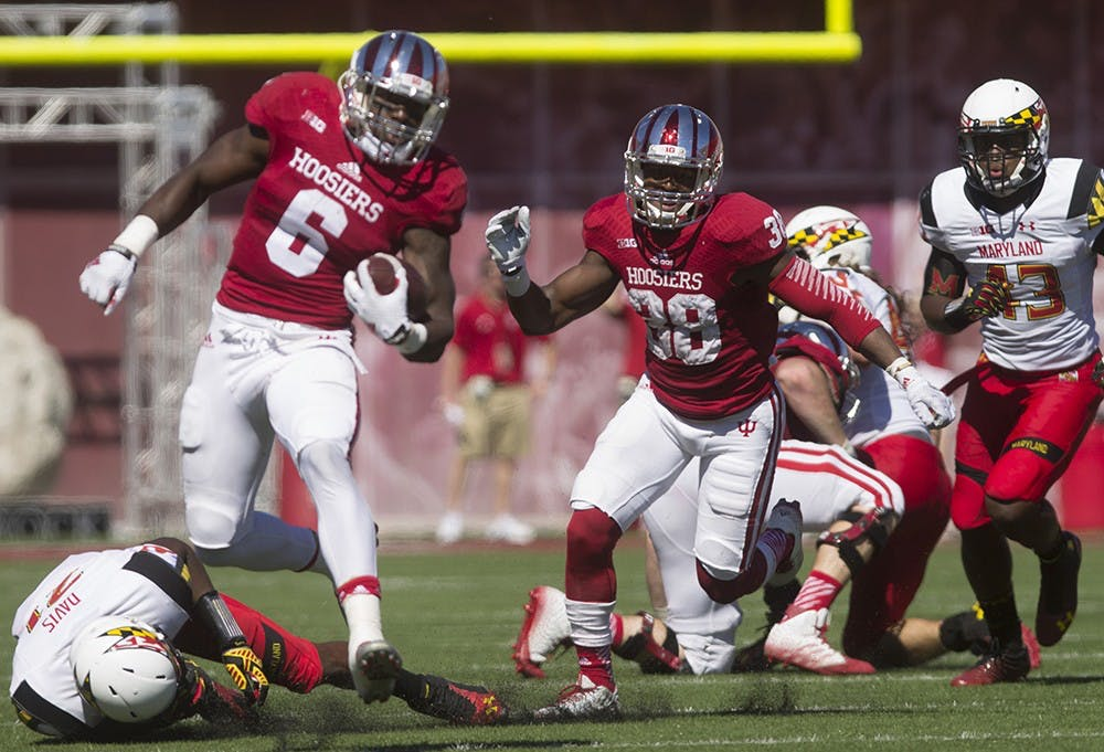 Junior Tevin Coleman breaks away from defenders during IU's game Saturday. Coleman reached the end zone on the play, but the touchdown was reversed by a penalty.