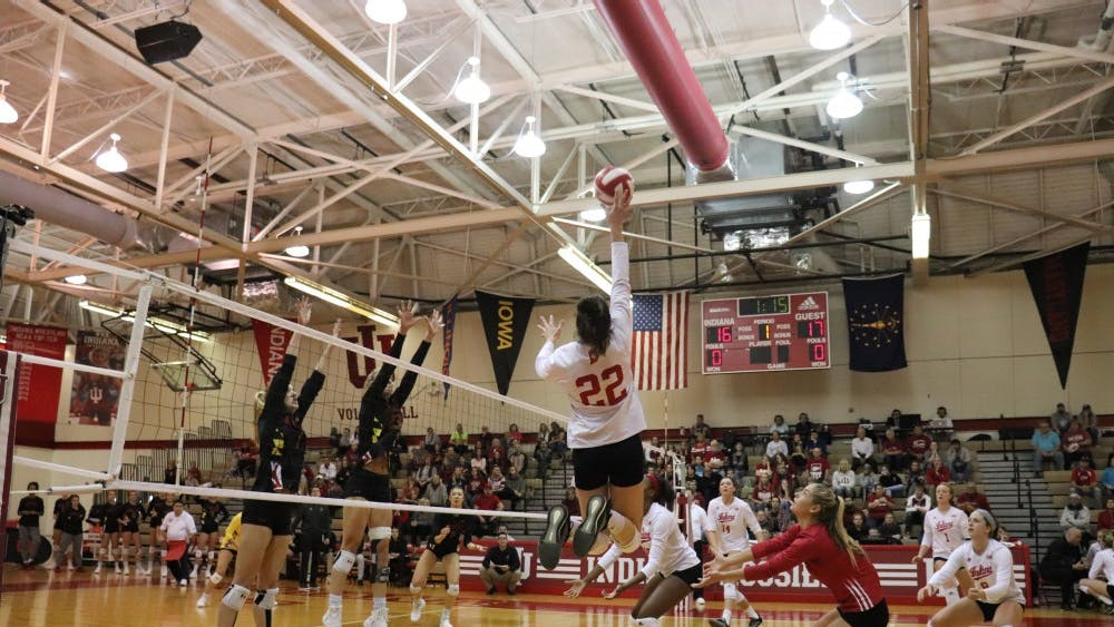 Sophomore outside hitter Kamryn Malloy hits the ball Oct. 21 in University Gym.