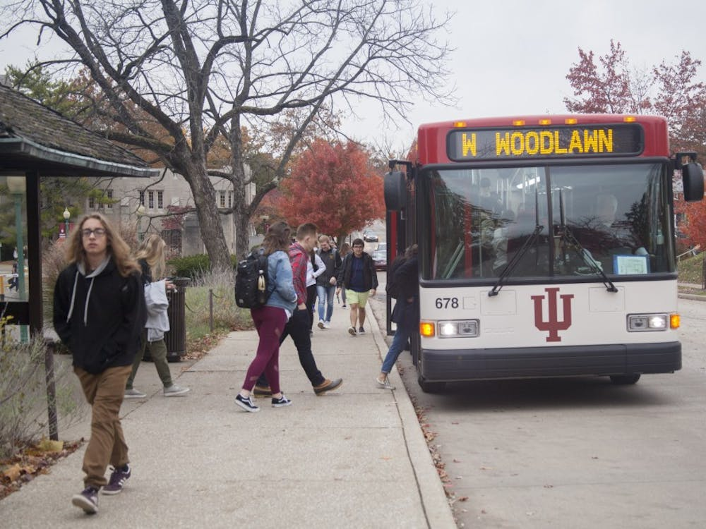 Students get onto a campus bus Nov. 5, 2018, on East Seventh Street. IU bus services are working with a transportation planning firm to improve bus routes.