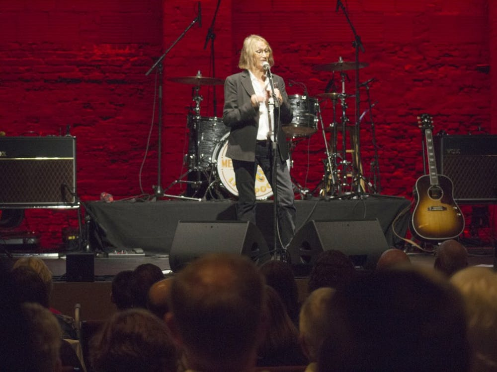 Laura Baird, John Lennon's sister, talks about her experience with the original Beatles band before the Mersey Beatles take the stage Friday night. The Buskirk-Chumley Theater was packed for the tribute band's third performance in Bloomington.