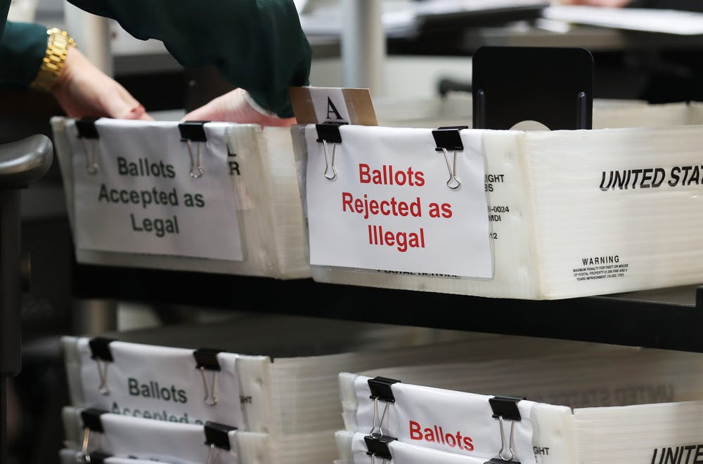 <p>Boxes for vote-by-mail ballots sit on a shelf. The U.S. Supreme Court upheld a Pennsylvania Supreme Court decision Oct. 19 that allows mail-in ballots to be counted until Nov. 6.</p>