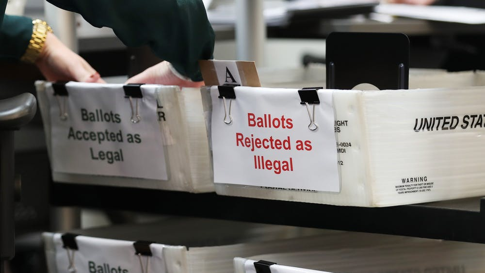 Boxes for vote-by-mail ballots sit on a shelf. The U.S. Supreme Court upheld a Pennsylvania Supreme Court decision Oct. 19 that allows mail-in ballots to be counted until Nov. 6.
