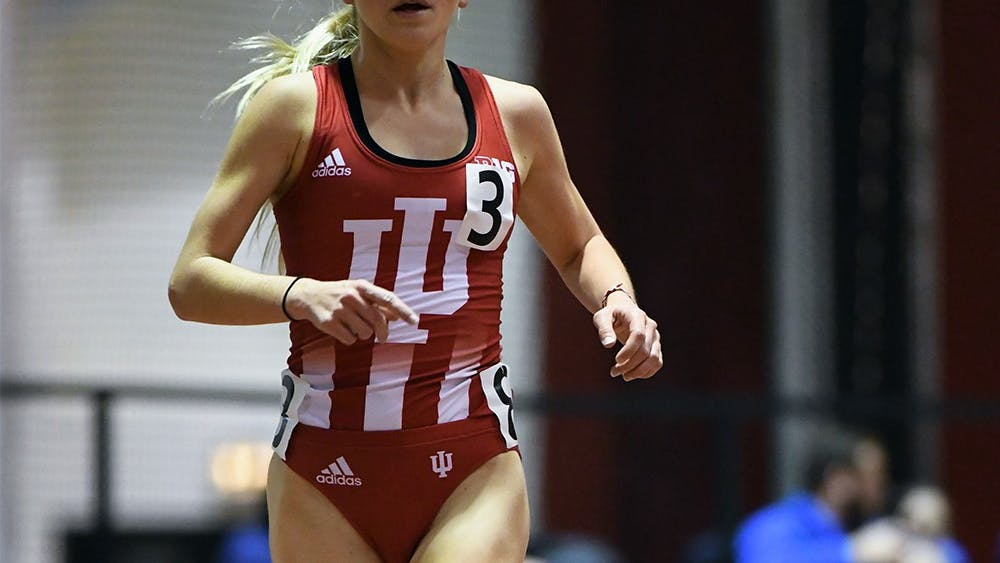 Junior Katherine Receveur races in the 5000 meter in the Hoosier Open in Harry Gladstein Fieldhouse. Receveur won the event in a new facility record time of 15:48.10. She, and six other teammates competed in the Alex Wilson Invitational this weekend.