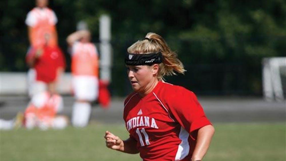 Junior forward Kristin Arnold plays the ball.