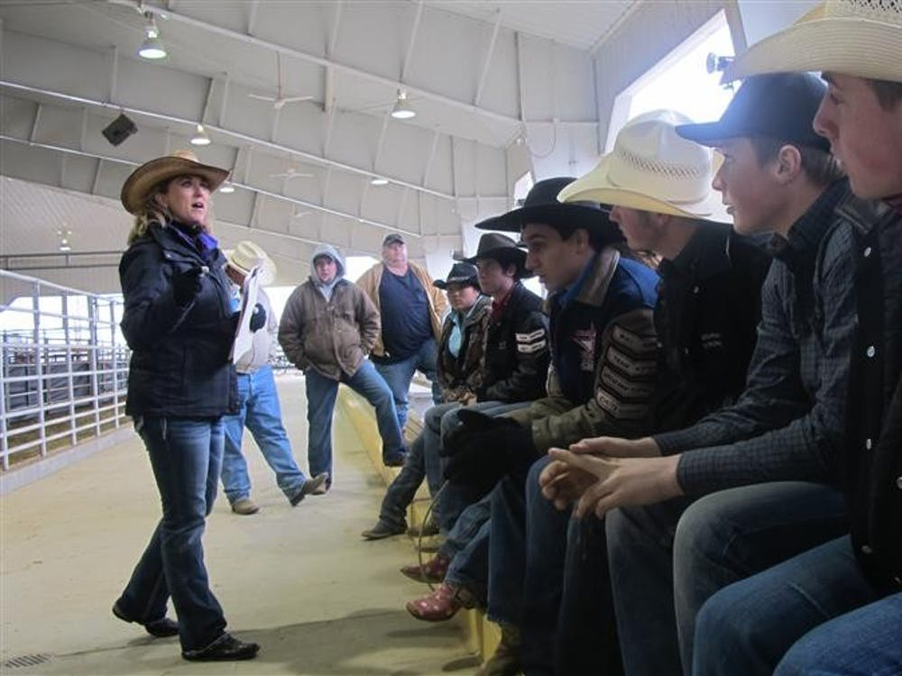 Indiana high School Rodeo Association president Angela Hoagland talks with the contestants before the start of the rodeo in Du Quoin, Ill. Rodeo contestants from Indiana, Illinois, Kentucky, Missouri, Tennessee and Arkansas came to compete at the Du Quoin State Fairgrounds.