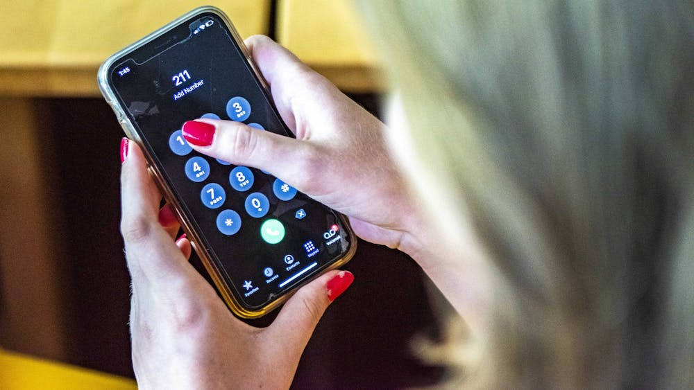 Someone dials 2-1-1 for Indiana's Be Well Crisis Helpline. The helpline connects callers to different health and human service resources.