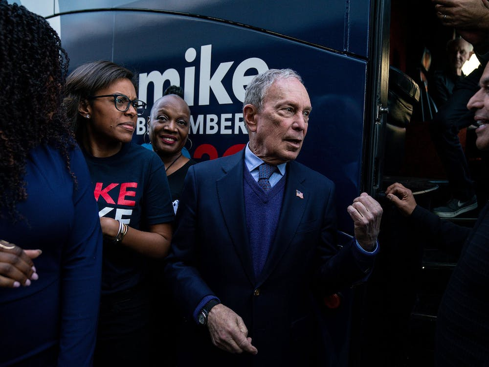 Democratic presidential candidate Michael Bloomberg speaks with former Los Angeles Mayor Antonio Villariagosa Feb. 3 after a campaign rally in Compton, California.