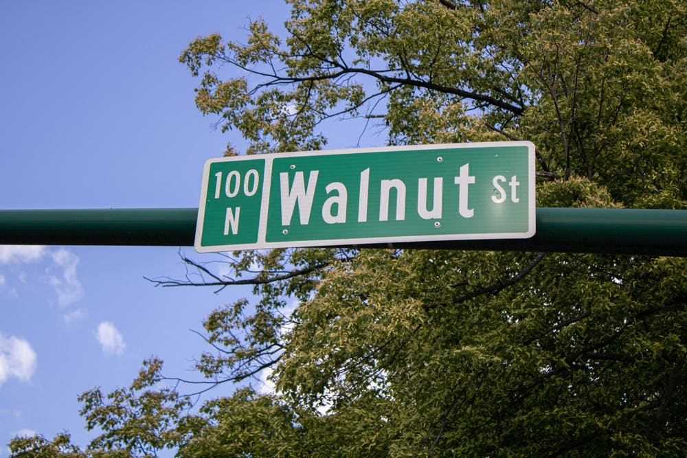 <p>A sign for Walnut Street is pictured May 13 at the corner of West Kirkwood Avenue and Walnut Street. Bloomington will receive a $300,000 grant which will be used to to investigate the environmental condition of properties in the College Avenue and Walnut Street area.</p>