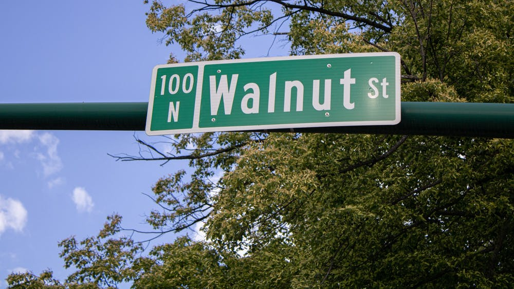 A sign for Walnut Street is pictured May 13 at the corner of West Kirkwood Avenue and Walnut Street. Bloomington will receive a $300,000 grant which will be used to to investigate the environmental condition of properties in the College Avenue and Walnut Street area.