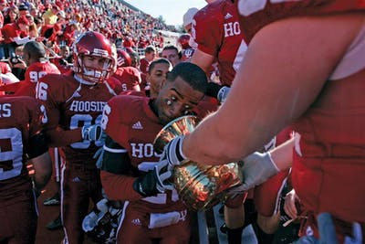 Then-sophomore safety Brandon Mosley prepares to spit into the Old Brass Spittoon after the Hoosiers' 46-21 victory against Michigan State in 2006 at Memorial Stadium. IU's win marked its first against the Spartans since 2001.