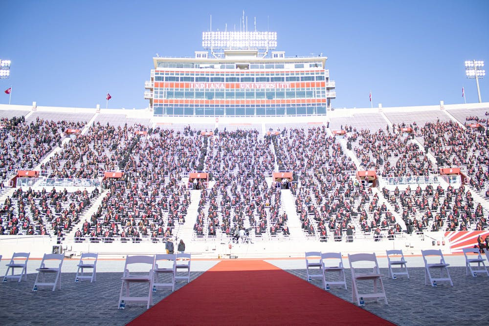 <p>Undergraduate students sit for the graduation ceremony May 8 at Memorial Stadium. Numerous students&#x27; information was leaked in a data breach through the cap and gown seller Herff Jones. </p>