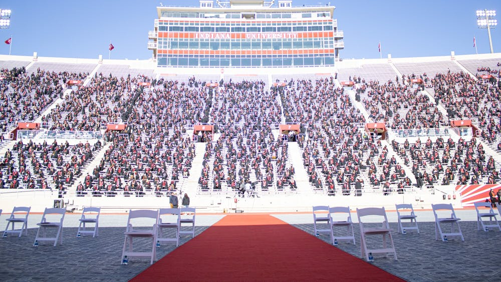 Undergraduate students sit for the graduation ceremony May 8 at Memorial Stadium. Numerous students' information was leaked in a data breach through the cap and gown seller Herff Jones.