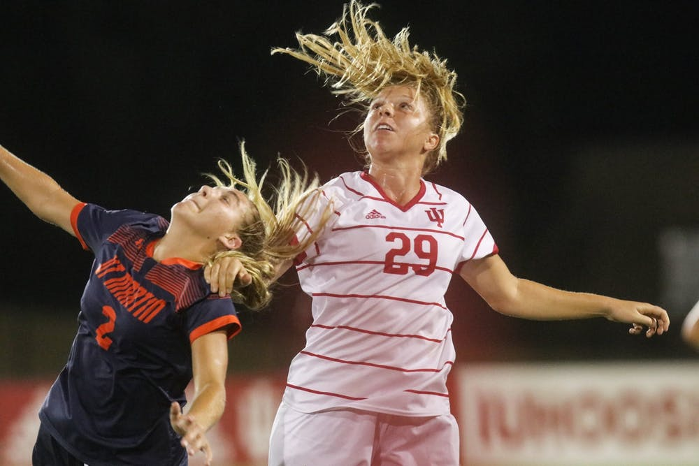 <p>Junior midfielder Alaina Kalin goes to head the ball Aug. 27, 2021, in Bill Armstrong Stadium. Indiana lost to Penn State 3-0 on Wednesday.</p>