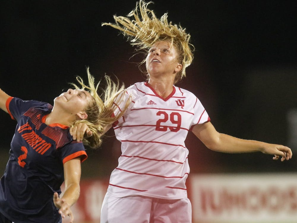 Junior midfielder Alaina Kalin goes to head the ball Aug. 27, 2021, in Bill Armstrong Stadium. Indiana lost to Penn State 3-0 on Wednesday.