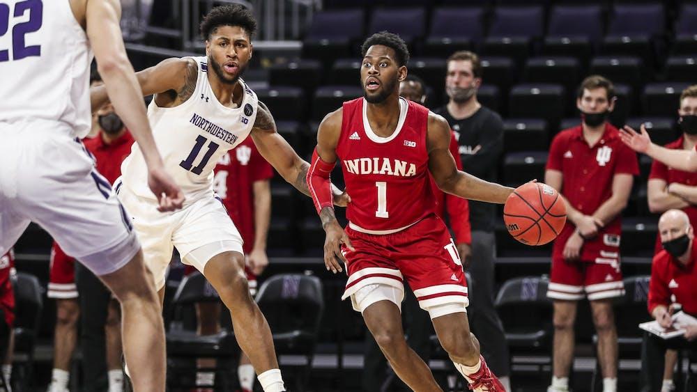 Senior guard Aljami Durham dribbles against the Northwestern defense Wednesday in Welsh Ryan Arena in Evanston, Illinois. IU defeated Northwestern 79-76 in double overtime.