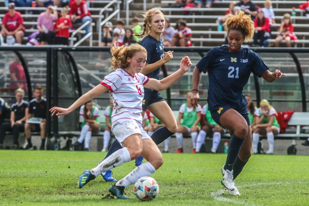 Junior midfielder Avery Lockwood goes to kick the ball Oct. 3, 2021, in Bill Armstrong Stadium against Michigan. Indiana women's soccer will play Penn State at 7 p.m. Wednesday.