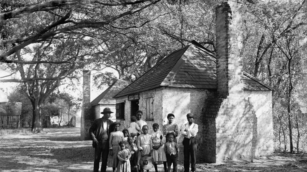 A Black family poses for a photo in approximately 1907 at the Hermitage Plantation in Savannah, Georgia.