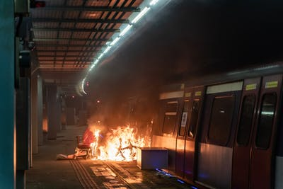 A fire is seen at an MTR station Nov. 13 during a demonstration at the Chinese University of Hong Kong in Hong Kong, China.