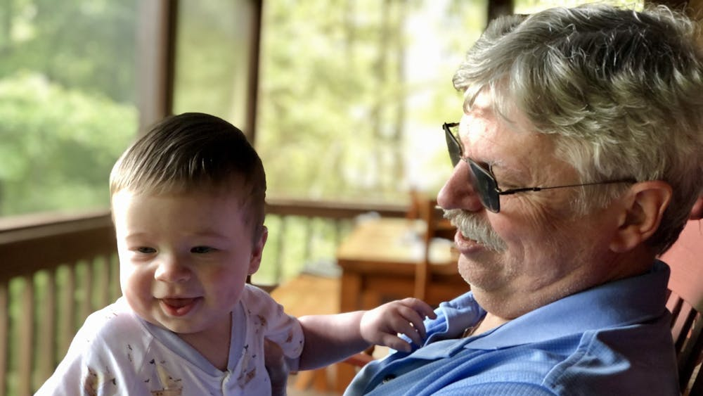 Craig Holden holds his grandson Aiden Tollison in Sept. 2020. Holden, Gregg T. and Judith A. Summerville Chair of Finance at the Kelley School of Business and chair of the finance department since 2018, died from an unexpected medical emergency April 3.