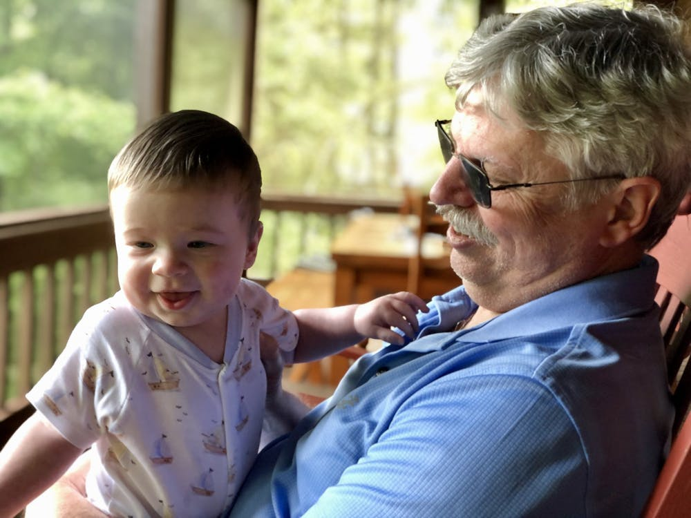 Craig Holden holds his grandson Aiden Tollison in September 2020. Holden, Gregg T. and Judith A. Summerville Chair of Finance at the Kelley School of Business and chair of the finance department since 2018, died from an unexpected medical emergency April 3.
