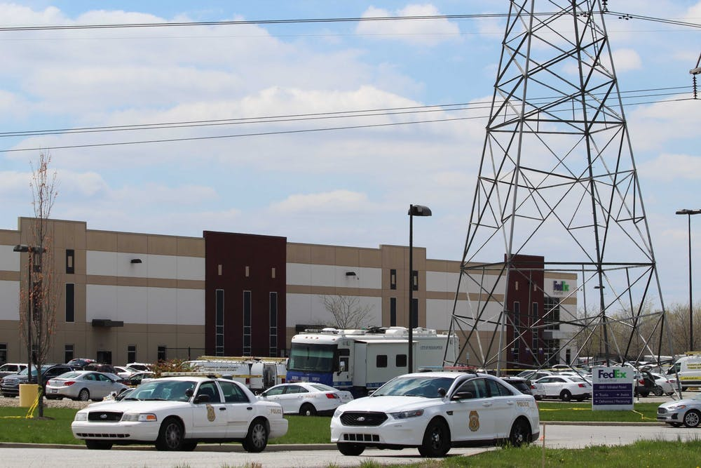 <p>Police cars block the entrance to the FedEx Ground Plainfield Operations Center on Friday in Plainfield, Indiana. The FedEx center was the site of a mass shooting Thursday, where a gunman killed eight people and then himself.</p><p><br/></p>