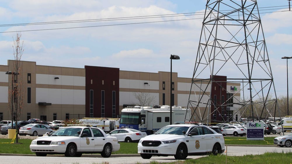 Police cars block the entrance to the FedEx Ground Plainfield Operations Center on Friday in Plainfield, Indiana. The FedEx center was the site of a mass shooting Thursday, where a gunman killed eight people and then himself.