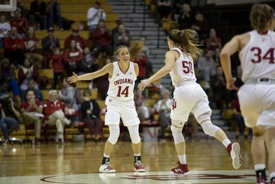 Redshirt junior Ali Patberg cheers on senior Brenna Wise after a play Dec. 15 at Simon Skjodt Assembly Hall. Patberg was able to score 18 points against Youngstown State University.