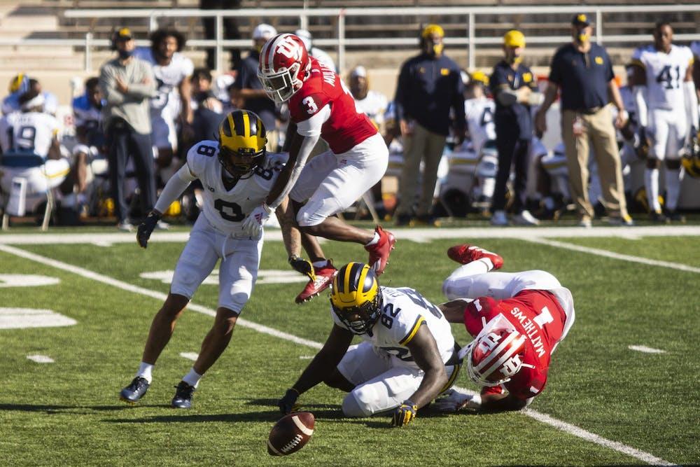 <p>Sophomore Tiawan Mullen jumps over the Michigan offense Nov. 7 at Memorial Stadium.&nbsp;</p>